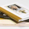 Fotoksiążki na papierze fotograficznym w okładce książkowej